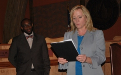 Councilwoman Jami McCain reads the recognition award for South Hills as Councilman Stephen Mason loo