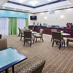 Complimentary breakfast area, offering tables and comfy chairs to guests..jpg