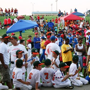 Teams in little league baseball wait for their turn to play..jpg