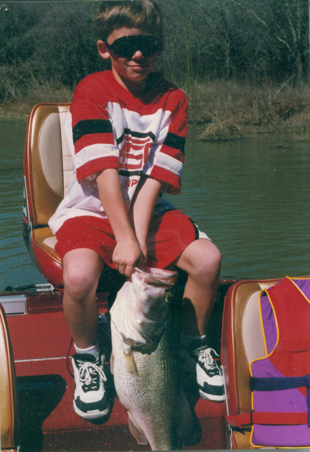 Matthew Rumbaugh of Cedar Hill Catches Trophy Bass from Joe Pool Reservoir completely by himself!