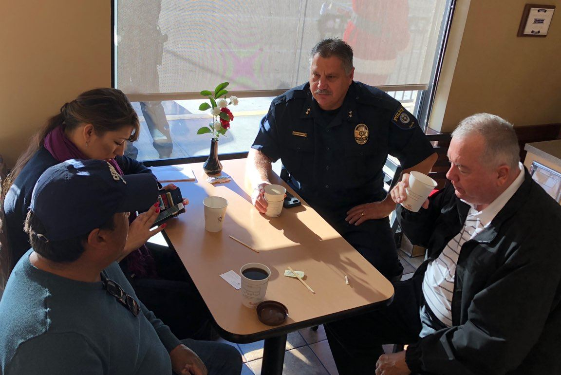 Police Department Members Having Coffee With Citizens