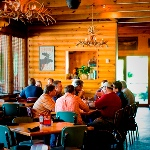 Groups of patrons enjoying their meals and conversations at Davids..jpg